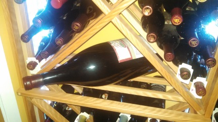 Wine Rack and Large Wine Bottle